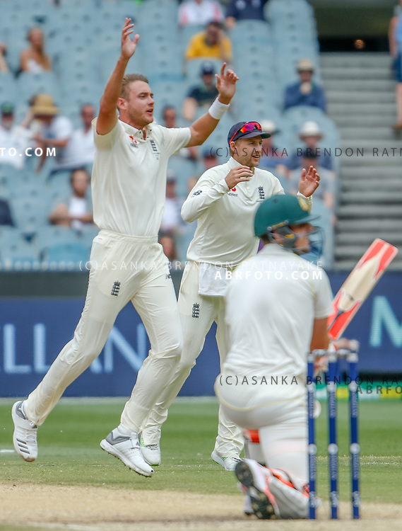 Stuart Broad and Joe Root jumps after a close chance of Mitchell Marshduring day 5 of the 2017 boxing day test.