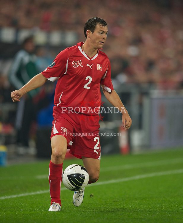 BASEL, SWITZERLAND - Tuesday, September 7, 2010: Switzerland's Stephan Lichtsteiner in action against England during the UEFA Euro 2012 Qualifying Group G match at St. Jakob-Park. (Pic by David Rawcliffe/Propaganda)