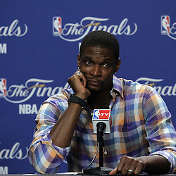 Jun 19, 2012; Miami, FL, USA; Miami Heat power forward Chris Bosh talks to the media during the post game press conference after game four in the 2012 NBA Finals against the Oklahoma City Thunder at the American Airlines Arena. Miami won 104-98. Mandatory Credit: Derick E. Hingle-US PRESSWIRE
