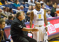 Nov 11, 2016; Morgantown, WV, USA; West Virginia Mountaineers guard Jevon Carter (2) talks with West Virginia Mountaineers head coach Bob Huggins on the bench during the second half against the Mount St. Mary's Mountaineers at WVU Coliseum. Mandatory Credit: Ben Queen-USA TODAY Sports