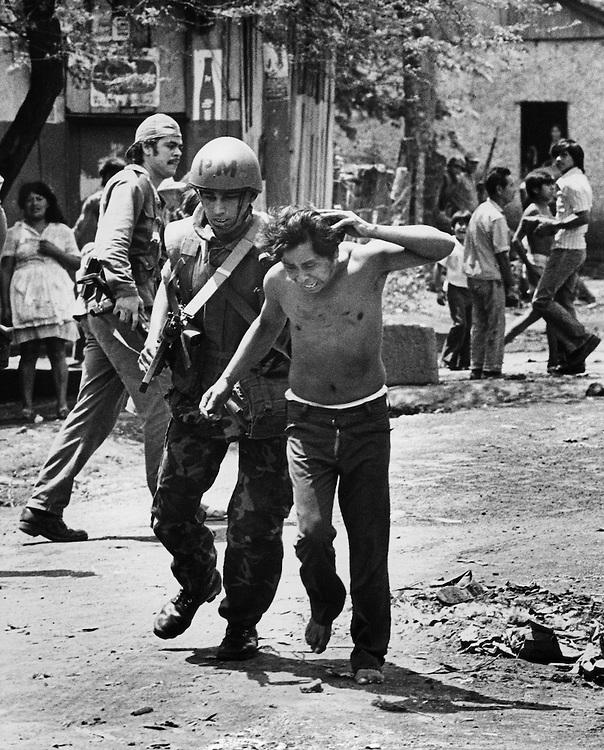 A Monimbo, Nicaragua resident is taken from his home by government National Guardsmen and pulled by the hair through the streets. The man - suspected of being a rebel Sandinista sympathizer - was found several hours later dead in an alleyway with a bullet wound to the back of his head.
