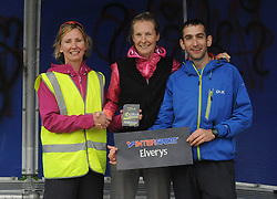 Colette Sweeney and Paul Feeney making the presentation to Deirdre Galvin Kilkenny who was the female winner of Westport Leisure Park's 'Last Man Running' on saturday last.<br /> Pic Conor McKeown