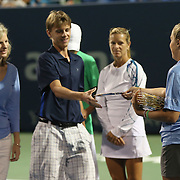 August 21, 2014, New Haven, CT:<br /> Participants and winners of the family classic are introduced during an on court presentation on day seven of the 2014 Connecticut Open at the Yale University Tennis Center in New Haven, Connecticut Thursday, August 21, 2014.<br /> (Photo by Billie Weiss/Connecticut Open)