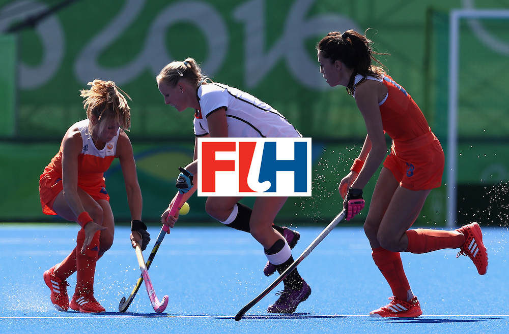 RIO DE JANEIRO, BRAZIL - AUGUST 13:  Hannah Kruger of Germany controls the ball during the Women's group A hockey match between the Netherlands and Germany on Day 8 of the Rio 2016 Olympic Games at the Olympic Hockey Centre on August 13, 2016 in Rio de Janeiro, Brazil.  (Photo by David Rogers/Getty Images)