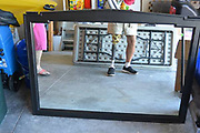 """Bizarre Photos of Mirrors Sold on Craigslist<br /><br />Eric Oglander estimates he's spent 700 hours on Craigslist looking for pictures of mirrors. The New York artist has culled through countless advertisements made by regular people throughout the country, and he's saved a few thousand of the most special ones.<br /><br />The """"specialness"""" of any particular mirror can be a funny detail, or a beautiful composition, but sometimes it's a heartbreaking moment, reflected by accident. Oglander rarely pays much attention to the words that accompany a Craigslist photo. He finds it means far less than the photo itself. """"Sometimes I think the text must include something like 'Isn't this a crazy photo!?!'' he admits, """"but it never does.""""<br />©Eric Oglander /Exclusivepix Media"""