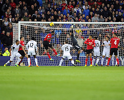 Cardiff City's Kevin Theophile Catherine heads over the bar from a corner - Photo mandatory by-line: Joe Meredith/JMP - Tel: Mobile: 07966 386802 03/11/2013 - SPORT - FOOTBALL - The Cardiff City Stadium - Cardiff - Cardiff City v Swansea City - Barclays Premier League