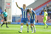 Wigan Midfielder Max Power with Goal scorer Wigan Striker Will Grigg during the Sky Bet League 1 match between Wigan Athletic and Southend United at the DW Stadium, Wigan, England on 23 April 2016. Photo by John Marfleet.