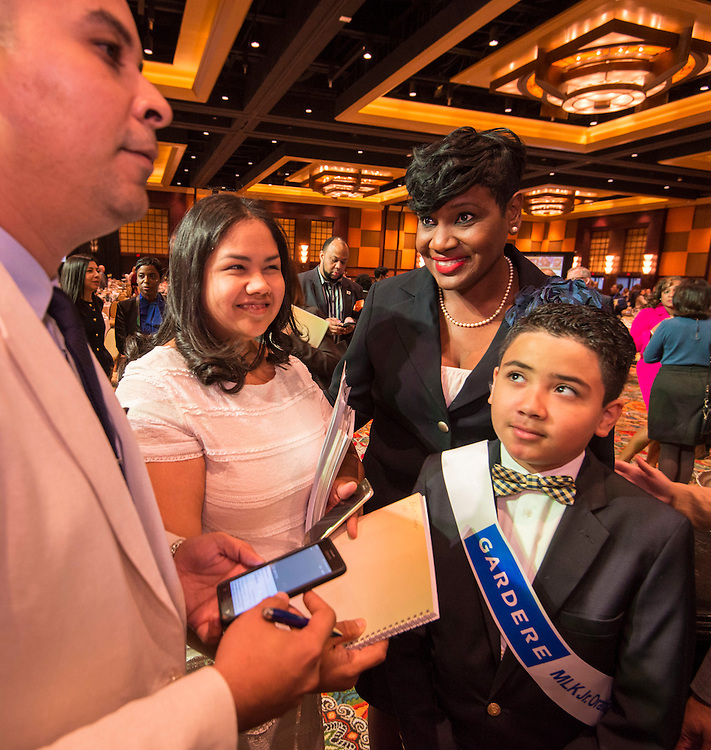 Houston ISD Trustee Wanda Adams talks with Nhedrick Jabier and his parents during the State of the Schools luncheon at the Hilton of the Americas, February 15, 2017.