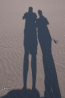 Silhouette of two friends on a beach in the Camargue, France