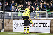 Harrogate Town midfielder Lloyd Kerry (17) joins Harrogate Town midfielder Michael Woods (21) celebrating Harrogate Town's third goal during the Vanarama National League match between FC Halifax Town and Dover Athletic at the Shay, Halifax, United Kingdom on 17 November 2018.