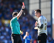 Barnet goalkeeper Jamie Stephens is shown the red card by referee Darren England during the Sky Bet League 2 match between Portsmouth and Barnet at Fratton Park, Portsmouth, England on 12 September 2015. Photo by David Charbit.