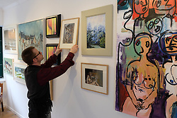 Pictured: Gallery owner Sean McKay makes final adjustments for the preview on Tuesday evening.<br /> <br /> More than 30 artists have contributed to Spring Fling's new Place exhibition, which explores sense of space and how it inspires.  The exhibition  at the Otterburn Gallery in Dumfries, will be available until 7 May 2018 <br /> <br /> Ger Harley | EEm Date