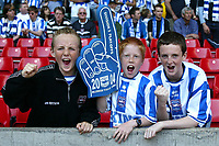 Fotball<br /> Photo Aidan Ellis, Digitalsport<br /> NORWAY ONLY<br /> <br /> Brighton and Hove Albion v Brisol City.<br /> Nationwide Divison 2 Play Off Final.<br /> Millenium Stadium Cardiff.<br /> 30/05/2004.<br /> Three young Brighton fans cheer their team on