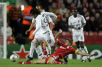 Photo: Paul Thomas/Sportsbeat Images.<br /> Liverpool v Besiktas. UEFA Champions League. 06/11/2007.<br /> <br /> Steven Gerrard (Ground) of Liverpool slides into tackle Ibrahim Toraman (58) of Besiktas.