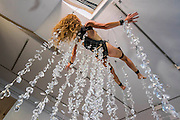 """Performance Artist Millie Brown performs """"Rainbow Body""""- a site specific performance installation, where she suspends her body surrounded by crystal prisms, from the ceiling of the gallery on Dover Street for the duration of Frieze one of the busiest weeks in the captial's art scene. Contemporary art gallery Gazelli Art House supports and presents a wide range of international artists."""