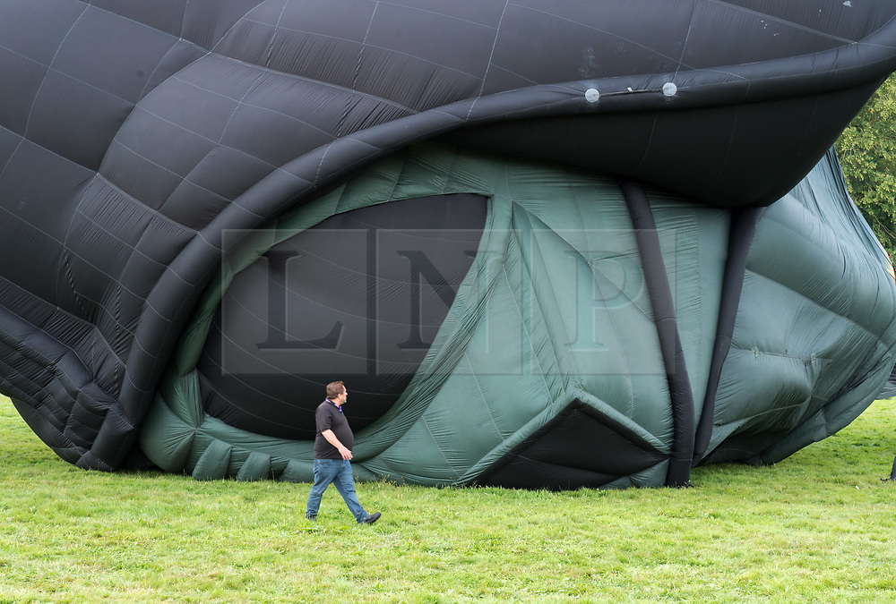 © Licensed to London News Pictures. 08/08/2019; Bristol, UK. The Darth Vader balloon character from Star Wars tethers at teatime, at the 41st Bristol International Balloon Fiesta 2019 which takes place from 08 - 11 August 2019. The evening mass ascent has been cancelled due to adverse windy weather, and the mass ascents for Friday have also been cancelled due to the weather forecast. For the first time in the event's history the first mass ascent of the fiesta was brought forward a day early due to the forecast for bad weather on Friday and Saturday. The Bristol International Balloon Fiesta attracts hundreds of thousands of visitors and this year the Fiesta will be celebrating Icons of Bristol and look to highlight some of the things that make up the home of the International Balloon Fiesta. The event has joined forces with Aerospace Bristol to honour one of the city's most famed creations, Concorde and Aardman Animations who are celebrating the 30th anniversary of Wallace and Gromit. Photo credit: Simon Chapman/LNP.