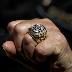 August 1, 2010; Metairie, LA, USA; New Orleans Saints owner Tom Benson holds up his Super Bowl XLIV championship ring during a training camp practice at the New Orleans Saints practice facility. Mandatory Credit: Derick E. Hingle