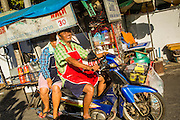 13 JANUARY 2013 - BANGKOK, THAILAND:  A street food vendor drives his cart home after a day at work in the Bang Luang neighborhood in Bangkok. The Bang Luang neighborhood lines Khlong (Canal) Bang Luang in the Thonburi section of Bangkok on the west side of Chao Phraya River. It was established in the late 18th Century by King Taksin the Great after the Burmese sacked the Siamese capital of Ayutthaya. The neighborhood, like most of Thonburi, is relatively undeveloped and still criss crossed by the canals which once made Bangkok famous. It's now a popular day trip from central Bangkok and offers a glimpse into what the city used to be like.     PHOTO BY JACK KURTZ