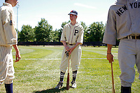 Cambridge, MA -  Daniel Monagle, 14 of Arlington (C) chats with his brother Cameron (L) while wearing old time Pittsburg Pirates and Cleveland Indians uniforms respectively on media day for the upcoming Oldtime Baseball Game at Saint Peter's Field on Monday, August 6, 2012.   Photo by Matthew Healey