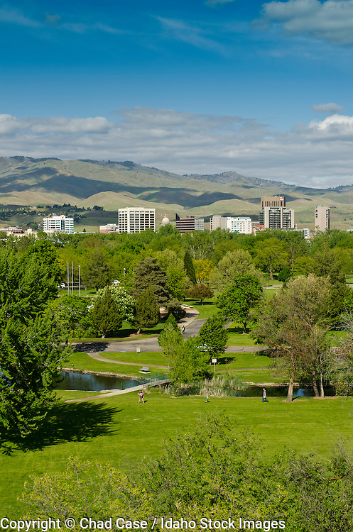 Boise, Idaho skyline with Ann Morrison Park in foreground and foothills beyond.