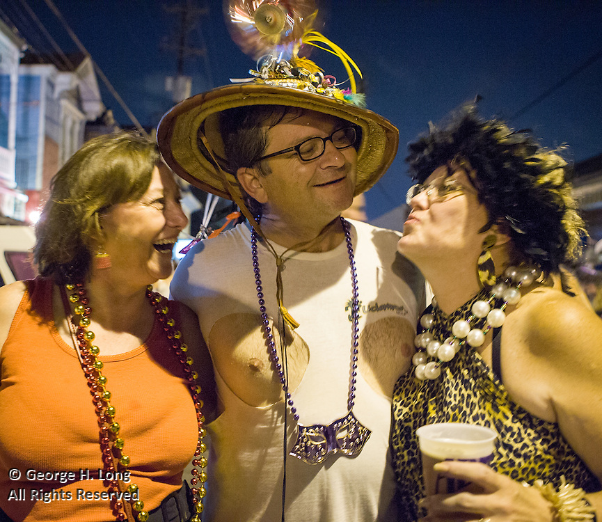 John Burke cutting up with friends at the Mid-Summer Mardi Gras Celebration; While many New Orleanians had already evacuated for Hurricane Katrina, others celebrated Mid-Summer Mardi Gras  with the Krewe of Oak outside the Maple Leaf Bar on Oak Street.  August 27, 2005