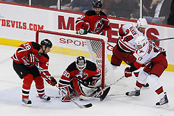 Apr 23, 2009; Newark, NJ, USA; New Jersey Devils goalie Martin Brodeur (30) makes a save on Carolina Hurricanes center Rod Brind'Amour (17) during the third period of game five of the eastern conference quarterfinals of the 2009 Stanley Cup playoffs at the Prudential Center. The Devils beat the Hurricanes 1-0 to take a 3-2 lead in the best of 7 series.