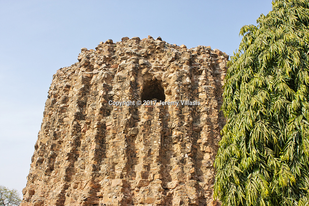 The Alai Minar is an incomplete tower that lies within the Qutub complex in Mehrauli, New Delhi. It's construction was abandoned after the death of Sultan Alauddin Khalji in 1316 AD. Today the tower stands as a massive red rubble structure at a height of 24.5 meters.