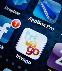 detail of iPhone 4G screen showing Trivago travel hotel booking  app