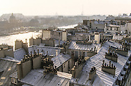 France. Paris. Elevated view on the Seine river. Eiffel Tower and Bridge over Seine, The seine river  , Sainte clotilde church bell tower,  the roofs . .  Paris  France   Paris