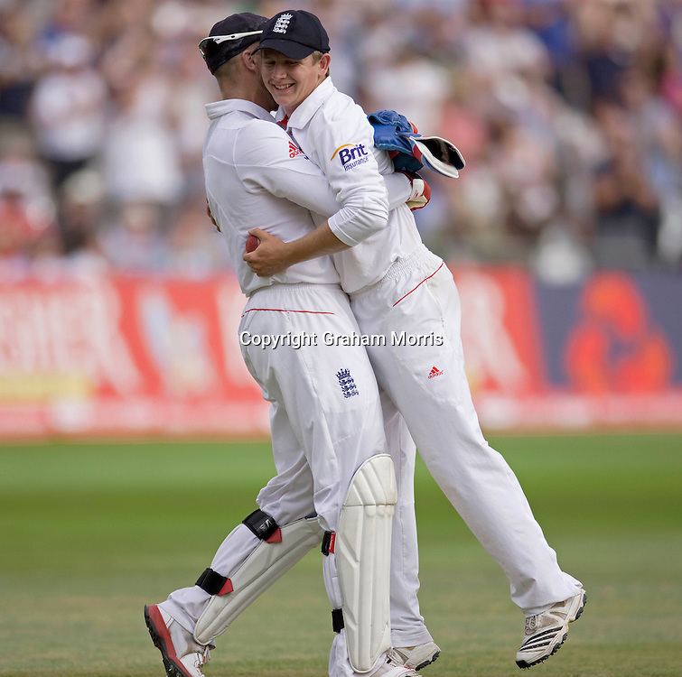 Substitute fielder, Scott Elstone, is hugged by wicket keeper Matt Prior after catching Harbhajan Singh off Tim Bresnan during the second npower Test Match between England and India at Trent Bridge, Nottingham.  Photo: Graham Morris (Tel: +44(0)20 8969 4192 Email: sales@cricketpix.com) 01/08/11