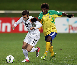New Zealand's Kosta Barbarouses and Solomon Islands' Jeffery Bule fight for the ball in a FIFA World Cup Qualifier Match, North Harbour Stadium, Auckland, New Zealand, Tuesday, September 11, 2012.  Credit:SNPA / David Rowland