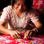 Lily Zhu makes a traditional cloth and bamboo umbrella at Guangdexing Paper Umbrella Shop, Meinong Township, Kaohsiung County, Taiwan
