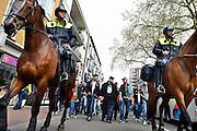 Nederland, Nijmegen, 5-4-2014Demonstratie ter ondersteuning van Geert Wilders en ter veroordeling van de aangifte van burgemeester Bruls, de Nijmeegse wethouders namens de Nijmeegse gemeenteraad. De stoet loopt onder zware politiebegeleiding door de stad naar het politiebureau. Organisator Angelo van den Bos doet vervolgens aangifte tegen de burgemeester wegens machtsmisbruik.Foto: Flip Franssen