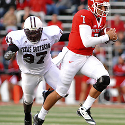 Oct 10, 2009; Piscataway, NJ, USA; Rutgers quarterback Tom Savage (7) evades Texas Southern defenders during second half NCAA college football action in Rutgers' 42-0 victory over Texas Southern at Rutgers Stadium.