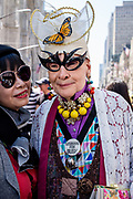 "New York, NY - April 16, 2017.  A woman in a elaborate costume including bat-woman glasses wears a pin reading ""Lesbians for Bush."""