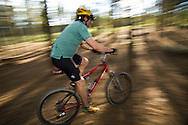A moutain biker pedals through the forest during summer near Nederland, Colorado