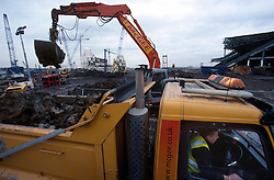 UK ENGLAND LONDON 24JAN03 - A digger loads earth onto a McGee truck leaving the Wembley Stadium construction site...jre/Photo by Jiri Rezac..© Jiri Rezac 2003..Contact: +44 (0) 7050 110 417.Mobile:  +44 (0) 7801 337 683.Office:  +44 (0) 20 8968 9635..Email:   jiri@jirirezac.com.Web:     www.jirirezac.com