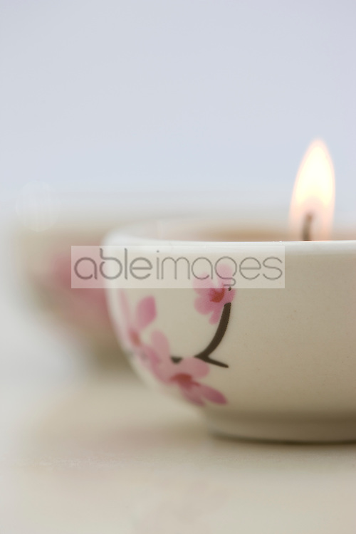 Close up of a burning pink tea light