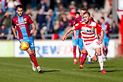 Doncaster Rovers midfielder Herbie Kane (15), on loan from Liverpool gives chase during the EFL Sky Bet League 1 match between Scunthorpe United and Doncaster Rovers at Glanford Park, Scunthorpe, England on 23 February 2019.