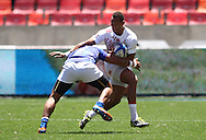 Alatasi Tupou of Samoa attempts to tackle Dan Norton of England during the match between England and Samoa <br /> of the HSBC Sevens World Series Port Elizabeth Leg held at the Nelson Mandela Bay Stadium on 7th December 2013 in Port Elizabeth, South Africa. (Photo by Shaun Roy/Sportzpics