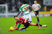 Oxford Utd's George Baldock is tackled by Yeovil Town's Francois Zoko during the Sky Bet League 2 match between Yeovil Town and Oxford United at Huish Park, Yeovil, England on 28 December 2015. Photo by Graham Hunt.