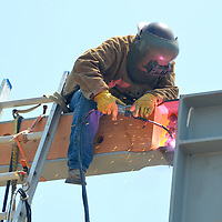 A welder works on a building at the Santa Monica Pier which will house a new eatery named Piazza Al Mare,. The restaurant is expected to open later this year and will offer three levels of dining including a rooftop dining terrace.  While enjoying family-style Italian cuisine, guests will be able to experience all the spectacular sky lines and amazing ocean views that the Santa Monica Pier has to offer.  The Al Mare restaurant is a new venture from Franco Sorgi and Paolo Simeone; owners of Trastevere restaurant on the Third Street Promenade and La Piazza in The Grove. Adding to the ambiance, Al Mare will also provide live music. Spanning 9,000 square feet, the facility will seat around 260 people. Al Mare is currently under construction, just west of the carousel building. .