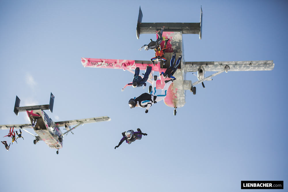 About 30 skydivers are exiting two skyvans for a bigway formation over Klatovy.