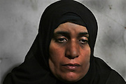 The mother of Adel Imam, a 21­‐year‐old who was shot by state security forces is photographed in her apartment in Cairo. Adel's parents did not know of his whereabouts for three days. His father searched all major hospitals and police stations in the capital before finally finding his body in the morgue in early February 2011, a few days after the start of the country's 18­‐day revolution.