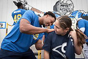Los Angeles Rams tight end Kendall Blanton signs an autograph during community improvement project at Belvedere Elementary School to upgrade play and social spaces around the school by building a new playground structure, painting murals and basketball backboards and landscaping., Friday, June 14, 2019, in Los Angeles, Calif. (Ed Ruvalcaba/Image of Sport)