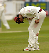London, GREAT BRITAIN, Northant's Usman AFZAAL, polishes the ball,  the during the first session  the Liverpool Victoria Div 2 County championship match between  Middlesex vs Northamptonshire, at Lords Cricket ground, England on Wed 25.04.2007  [Photo, Peter Spurrier/Intersport-images].....