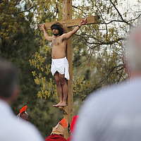 """Christian Acosta stands as the cruicified """"Christ"""" Friday during St. James Cathoic Churhes Stations of the Cross which depict the final hours of Jesus Chirst."""