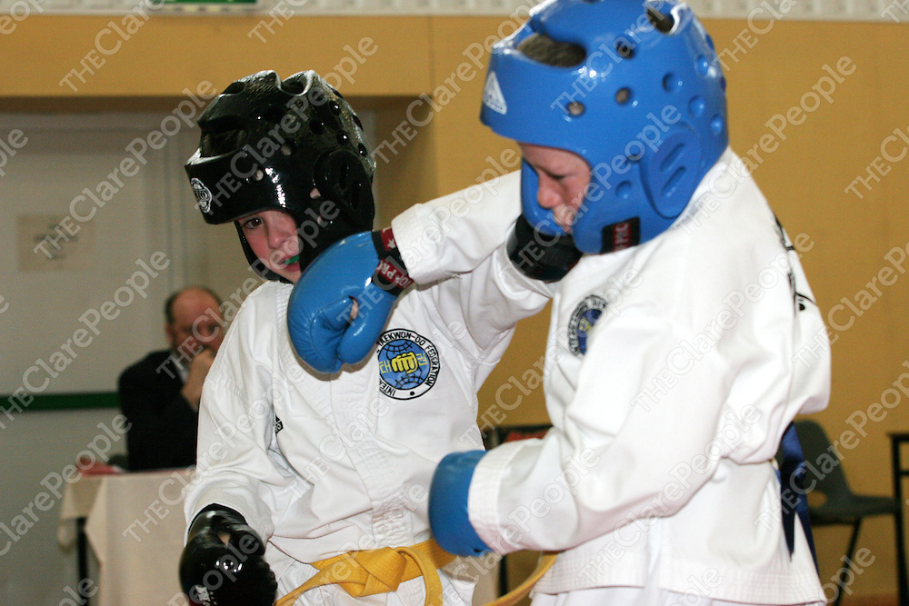 16.10.05.<br /> Geoff McGowan (7), Quinn Tae Kwon Do (right) spars with Christian Vickery, Feythe Tae Kwon Do Tae Kwon Do at the All Ireland Tae Kwan Do Championships in St. Flannans School Ennis. Picture: Alan Place/Press 22.