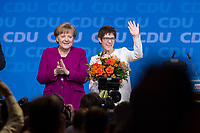 26 FEB 2018, BERLIN/GERMANY:<br /> Angela Merkel (L), CDU, Bundeskanzlerin, und Annegret Kramp-Karrenbauer (R), CDU Generalsekretaerin, nach der Wahl, CDU Bundesparteitag, Station Berlin<br /> IMAGE: 20180226-01-167<br /> KEYWORDS: Party Congress, Parteitag, Blumen, flowers, Jubel, Applaus, klatschen, applaudieren
