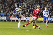 Reading midfielder Daniel Williams and Bristol City midfielder Luke Freeman during the Sky Bet Championship match between Reading and Bristol City at the Madejski Stadium, Reading, England on 2 January 2016. Photo by Jemma Phillips.